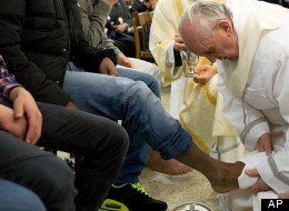 Pope Francis washing the feet of inmates at a juvenile detention center, Huffington Post.