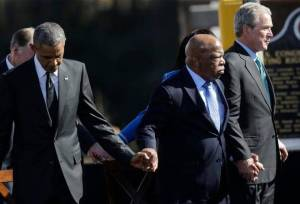 President Barak Obama, Congressman John Lewis and former President George W. Bush hold hands during the 50th Anniversary Commemoration of the Selma Marches in March, 1965. Photo Credit: Gerald Herbert, Associated Press