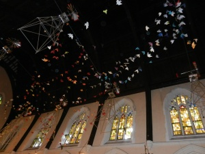 Image: paper prayer cranes in the sanctuary of Broad Street Ministries in Philadelphia, PA